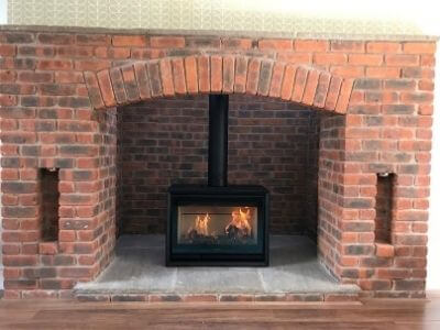 red brick chimney with stove