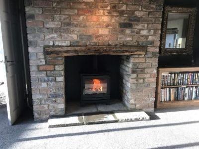grey-brick-chimney-breast-with-stove-beam